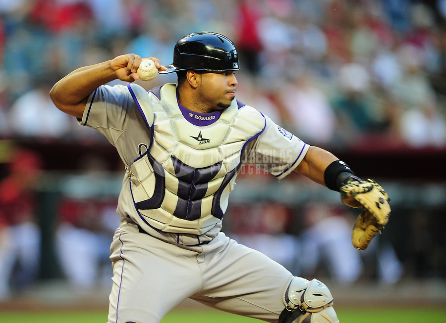 Jun. 6, 2012; Phoenix, AZ, USA; Colorado Rockies catcher Wilin Rosario throws to second base on a pickoff attempt in the second inning against the Arizona Diamondbacks at Chase Field.  Mandatory Credit: Mark J. Rebilas-