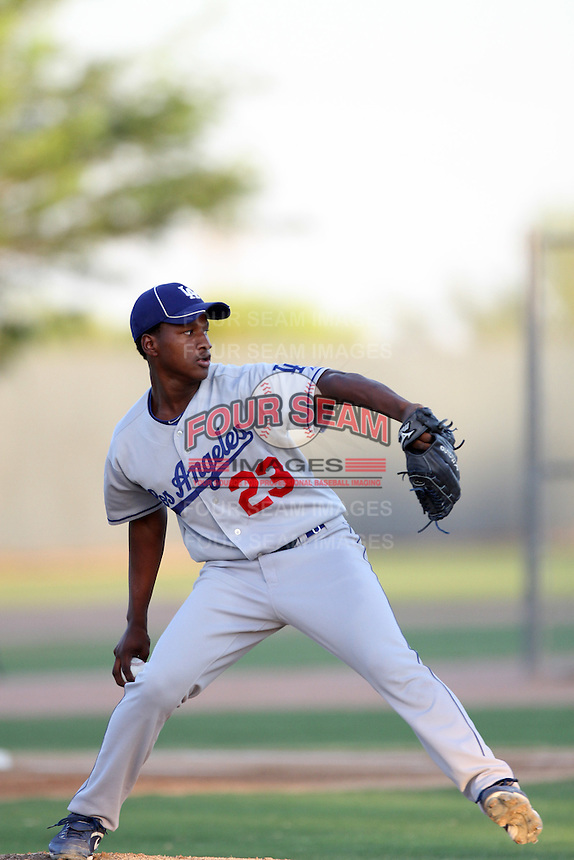 Victor Araujo #23 of the AZL Dodgers pitches against the AZL Athletics at Papago Park Baseball Complex on July 25, 2012 in Phoenix, Arizona. Dodgers defeated A's 3-1. (Larry Goren/Four Seam Images)