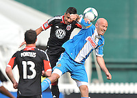 Marcelo Saragosa (11) of D.C. United goes against Conor Casey (6) of the Philadelphia Union. The Philadelphia Union defeated D.C. United 3-2, at RFK Stadium, Sunday April 21, 2013.