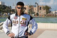 Tripoli, Libya - Young Libyan Man in Nascar Jacket, National Museum, Serraya al-Hamra in Background.