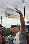 Assistant Coach Jon Collins holds up a play book during football practice on Wednesday Oct. 12, 2011 at Breathitt County High School in Jackson, Ky. The team is preparing for Friday night's football game against the Morgan County Cougars. Photo by Rachel Aretakis