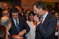 King Felipe VI of Spain tries serrano ham during tourism fair FITUR in Madrid, Spain. Month XX, 2015. (ALTERPHOTOS/Victor Blanco) /nortephoto.com<br /> nortephoto.com