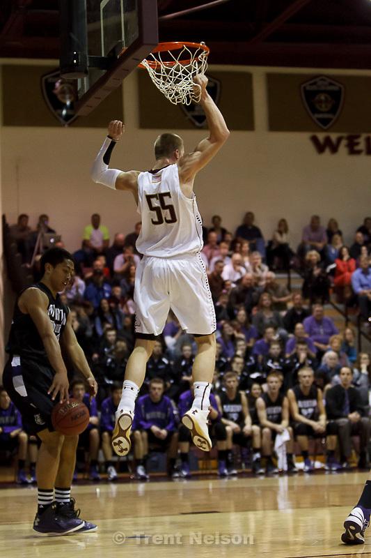 Trent Nelson  |  The Salt Lake Tribune.Lone Peak's Eric Mika dunks as Lone Peak hosts Riverton High School basketball Wednesday January 9, 2013 in Highland.