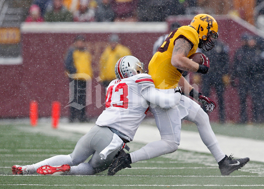 Ohio State Buckeyes linebacker Darron Lee (43) makes a tackle on Minnesota Golden Gophers tight end Maxx Williams (88) during the 1st quarter at TCF Bank Stadium in Minneapolis, Minn. on November 15, 2014.  (Dispatch photo by Kyle Robertson)