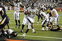 26 December 2010:  FIU running back Darriet Perry (28) celebrates his second-half touchdown as the FIU Golden Panthers defeated the University of Toledo Rockets, 34-32, to win the 2010 Little Caesars Pizza Bowl at Ford Field in Detroit, Michigan.
