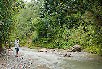 American herpetology student Eric Leatham walks beside the Meleotigi River, near the village of Eraulo in the Ermera District of Timor-Leste (East Timor). Leatham is part of an ongoing survey of Timorese reptiles and amphibians.