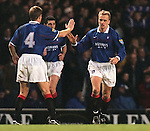Jonas Thern celebrates scoring for Rangers as he takes the acclaim of Richard Gough