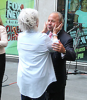 NEW YORK, NY - JULY 7:  Paula Deen, celebrating National Fried Chicken Day at 'Fox and Friends', greets Bo Dietl who has a handful and a mouthful of fried chicken in New York, New York on July 7, 2016.  Photo Credit: Rainmaker Photo/MediaPunch