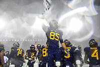 Morgantown, WV - NOV 19, 2016: West Virginia Mountaineers wide receiver Ricky Rogers (85) gets the crowd hyped up during game between West Virginia and Oklahoma at Mountaineer Field at Milan Puskar Stadium Morgantown, West Virginia. (Photo by Phil Peters/Media Images International)