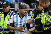 Seattle, WA - Tuesday June 14, 2016: Security, Fan during a Copa America Centenario Group D match between Argentina (ARG) and Bolivia (BOL) at CenturyLink Field.