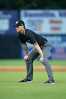 Umpire Mark Bass handles the calls on the bases during the Appalachian League game between the Pulaski Yankees and the Danville Braves at American Legion Post 325 Field on August 2, 2016 in Danville, Virginia.  The game was cancelled due to rain.  (Brian Westerholt/Four Seam Images)