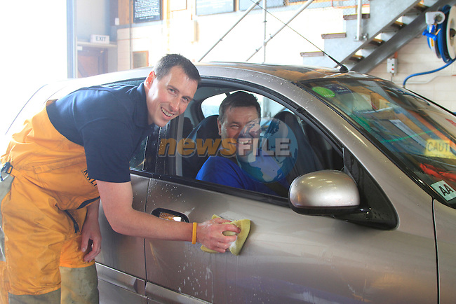 Derek Shevlin and Pat Fitzpatrick during the &quot;Car Wash&quot; in aid of the Clogherhead RNLI Lifeboat on Saturday 12th July 2014.<br /> Picture:  Thos Caffrey / www.newsfile.ie