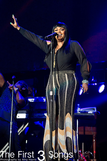 Jill Scott performs during the 2014 Essence Festival at the Mercedes-Benz Superdome in New Orleans, Louisiana.
