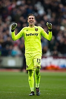 Goalkeeper Adrian of West Ham United celebrates his teams win at full time during the Premier League match between West Ham United and Chelsea at the Olympic Park, London, England on 9 December 2017. Photo by Andy Rowland.