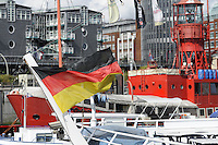 German flag on boat in docks of Hamburg port