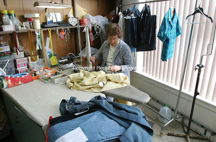 WATERBURY, CT 21 October 2005 -102105BZ02- Seamstress Peggy Barolli does alterations at West Side Cleaners on West Main Street in Waterbury.  Three businesses- Town and Country Florist, West Side Cleaners, and New Moon Chinese Restaurant- are facing eviction to make room for the construction of a new bank branch.<br />  Jamison C. Bazinet / Republican-American