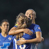 Allston, Massachusetts - July 9, 2015:   In a National Women's Soccer League (NWSL) match, FC Kansas City (white) defeated Boston Breakers (blue), 3-2, at Soldiers Field Soccer Stadium. Kristie Mewis celebrates her goal.