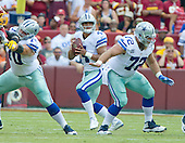 Dallas Cowboys quarterback Dak Prescott (4) looks for a receiver in early first quarter action against the Washington Redskins at FedEx Field in Landover, Maryland on Sunday, September 18, 2016.  Blocking for Prescott are guard Zack Martin (70) and center Travis Frederick (72).<br /> Credit: Ron Sachs / CNP