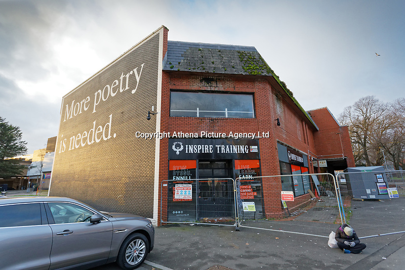 "The ""More Poetry Is Needed"" graffiti, produced by Jeremy Deller for the Dylan Thomas Centenary, in the city centre of Swansea, Wales, UK. Saturday 04 January 2019"