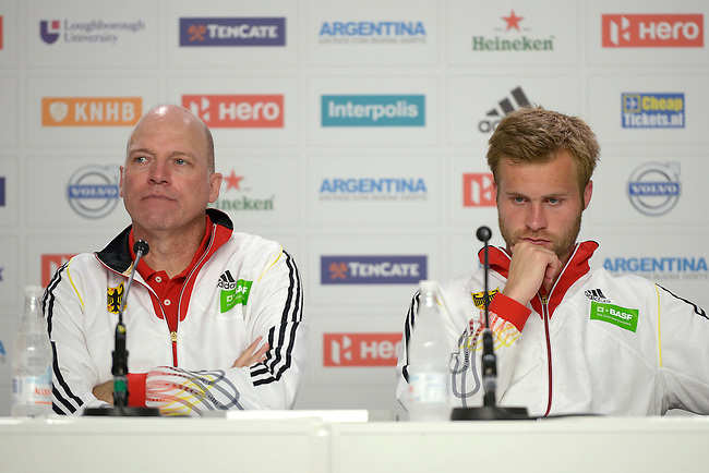 The Hague, Netherlands, June 08: Head coach Jochen Heimpel of Germany and Maximilian Mueller #4 of Germany during the press conference after the field hockey group match (Men - Group B) between the Black Sticks of New Zealand and Germany on June 8, 2014 during the World Cup 2014 at Kyocera Stadium in The Hague, Netherlands. Final score 3-5 (1-3) (Photo by Dirk Markgraf / www.265-images.com) *** Local caption ***