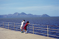 Two Nicaraguan girls enjoying the view of Lake Xolotlan from the Malecon promenade in  Managua, Nicaragua