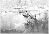 RGS K-27 #461 with dismantling train on Bridge 45-B at Ophir during scrapping operation.<br /> RGS  Ophir, CO  Taken by Reid, Homer