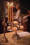 Loaves and candles. Christmas Eve Vigil Service, St. Sava Serbian Orthodox Church, Jackson, Calif. The five loaves symbolize the loaves from the wilderness which Christ fed the masses. The three candles symbolist the Holy Trinity.
