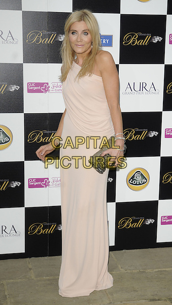 MICHELLE COLLINS .Attending The Grand Prix Ball at The Hurlingham Club, London, England, .UK, 7th July 2010. .full length pink beige draped ruched one shoulder long maxi grecian dress clutch bag nude.CAP/CAN.©Can Nguyen/Capital Pictures.