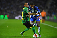 27th October 2019; Dragao Stadium, Porto, Portugal; Portuguese Championship 2019/2020, FC Porto versus Famalicao; Wilson Manafá of FC Porto is held back by Lionn of Famalicao