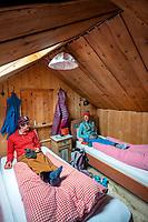 A couple sits relaxing inside the Bella Vista mountain hut during the Öztal ski tour, Austria