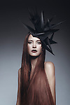 Caucasian female model wearing unusual black headdress