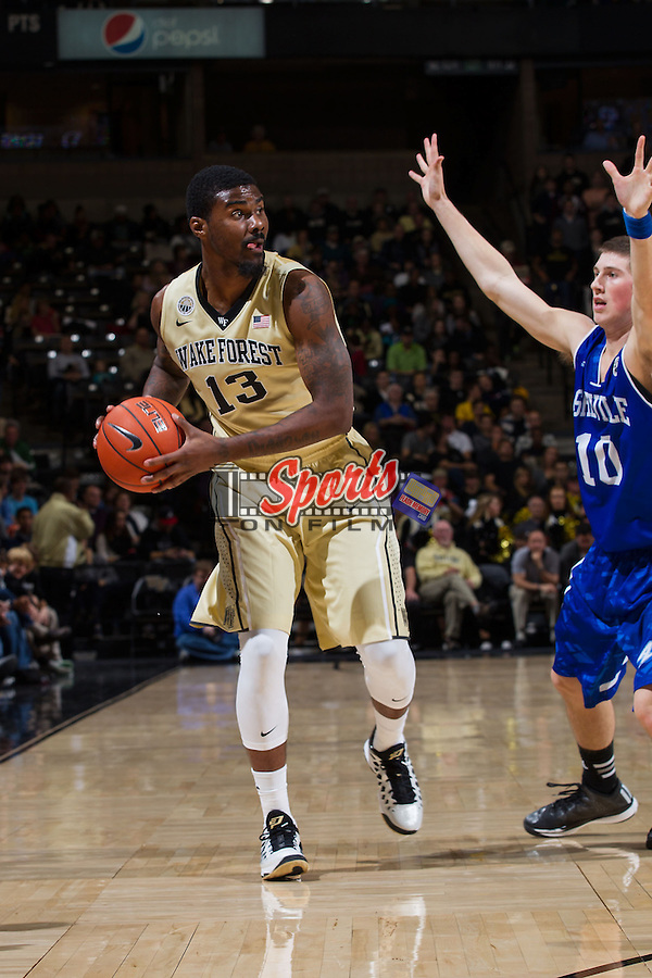 Darius Leonard (13) of the Wake Forest Demon Deacons is guarded by Kevin Vannatta (10) of the UNC Asheville Bulldogs during second half action at the LJVM Coliseum on November 14, 2014 in Winston-Salem, North Carolina.  The Demon Deacons defeated the Bulldogs 80-69  (Brian Westerholt/Sports On Film)