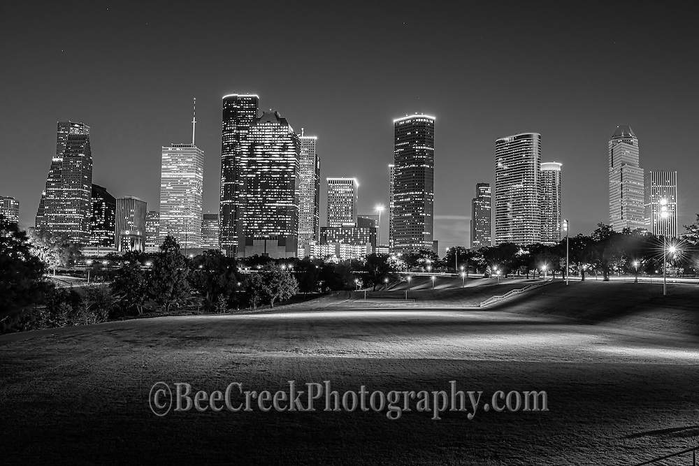 Houston Skyline BW -  Houston skyline in black and white at night in the park in downtown that runs along the bayou. When they turn the lights on in the park we thought it would ruin our image but instead it made it look even better in our opinion.