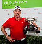 Miguel Angel Jimenez of Spain poses with the trophy after winning the UBS Hong Kong Open Championship at the Hong Kong Golf Club on 18 November 2012, in Fanling. Photo by Victor Fraile / The Power of Sport Images