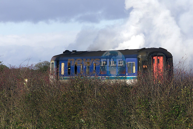 The NI Trains carrage smouldering on the Main Belfast Dublin Rail Line after it went on fire outside Drogheda..Pic Fran Caffrey Newsfile.©Newsfile Ltd..Copy Elain Keogh