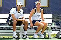 18 March 2012:  FIU Assistant Coach Dimitrio Martinez speaks with Nina Djordjevic during a break in her singles match against Colubmia's Tiana Takenaga as the Columbia Lions defeated the FIU Golden Panthers, 5-2, at University Park in Miami, Florida.