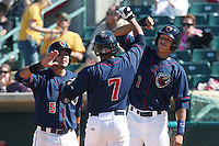 Rio Ruiz #5 and Carlos Correa #1 of the Lancaster JetHawks greet teammate Brandon Meredith #7 after Meredith's home run during a game against the Lake Elsinore Storm at The Hanger on April 6, 2014 in Lancaster, California. Lancaster defeated Lake Elsinore, 7-4. (Larry Goren/Four Seam Images)