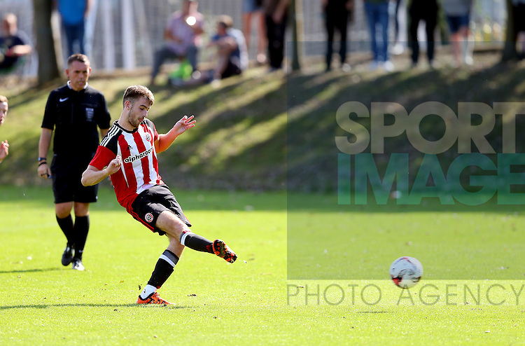 Ben Whiteman of Sheffield Utd scores a penalty during the Professional Development League Two match at Shirebrook Training Complex, Sheffield. Picture date: September 13th, 2016. Pic Simon Bellis/Sportimage