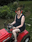 Mowing grass with power mower