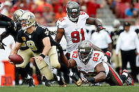 TAMPA, FL - SEPTEMBER 15: Defensive Tackle Gerald McCoy #93 of the Tampa Bay Buccaneers sacks Drew Brees #9 alongside Defensive End Da'Quan Bowers #91 during the game against the New Orleans Saints at Raymond James Stadium on September 15, 2013, in Tampa, Florida. The Buccaneers lost 16-14. (photo by Matt May/Tampa Bay Buccaneers)