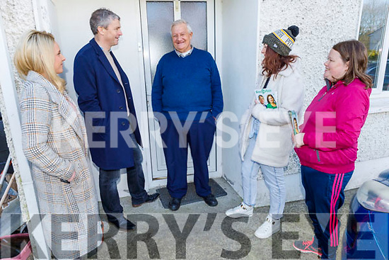 Tom Moore at his door talking with Pa Daly in Currow on Sunday,