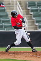 Adam Engel (23) of the Kannapolis Intimidators connects on a 3-run home run against the Greenville Drive at CMC-Northeast Stadium on April 6, 2014 in Kannapolis, North Carolina.  The Intimidators defeated the Drive 8-5.  (Brian Westerholt/Four Seam Images)