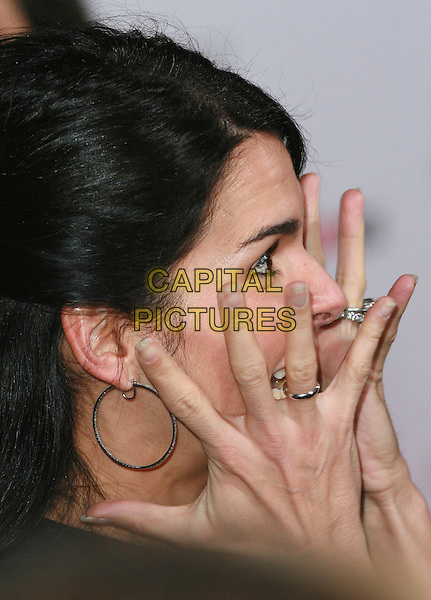 """ANGIE HARMON.""""The Pursuit of Happyness"""" Premiere held at Mann Village Theater, Westwood, California, USA,.December 7th 2006..portrait headshot hands rings.CAP/ADM/CH.©Charles Harris/Admedia/Capital Pictures"""