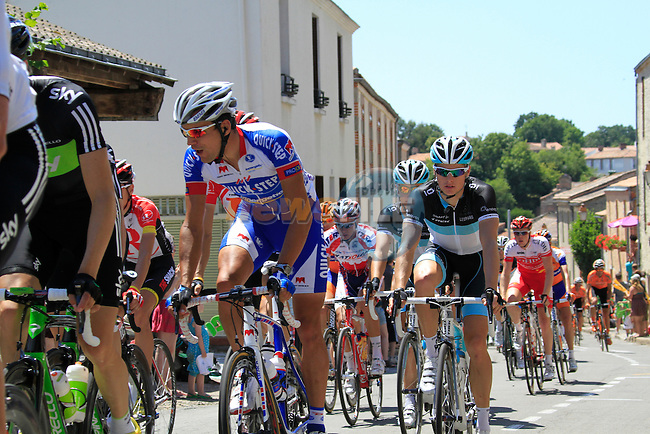 The pelethon pass through the town of Apremont during the 3rd Stage of the 2011 Tour de France, 198k from Olonne-sur-Mere to Redon, 4th July 2011 (Photo by Eoin Clarke/NEWSFILE)