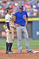 Chicago Cubs third baseman Kris Bryant (17) talks with shortstop Chase d'Arnaud (23) during a game against the Atlanta Braves at Turner Field on June 11, 2016 in Atlanta, Georgia. The Cubs defeated the Braves 8-2. (Tony Farlow/Four Seam Images)
