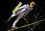 Andreas Kuettel of Switzerland soars through the night during the FIS World Cup Ski Jumping in Sapporo, northern Japan in February, 2008.