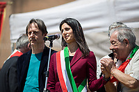 Virginia Raggi (Mayor of Rome, Five Star Movement) & Mario Di Maio (Antifascist Partizan. Member of the Partigiani: the Italian Resistance during WWII).<br /> <br /> Rome, 25/04/2018. Today, to mark the 73rd Anniversary of the Italian Liberation from nazi-fascism ('Liberazione'), ANED Roma & ANPI Roma (National Association of Italian Partizans) held a march ('Corteo') from Garbatella to Piazzale Ostiense where a rally took place attended by Partizans, Veterans and politicians – including the Mayor of Rome and the President of Lazio's Region. From the organisers Facebook page:<<For the 25th of April, the 73rd Anniversary of the Liberation of Italy from nazi-fascism, while facing new threats to the world peace, it is necessary to remember that the Fight for Liberation triggered the greatest, positive, 'break' of the whole modern age of the Italian history. The Fight for the Liberation was supported by a great solidarity of the people. The memory of those who in the partizan struggle, in the camps of imprisonment, internment or extermination, opposed - even until the sacrifice of life - the dictatorship, the greed of territorial conquests, crazy ideologies of race supremacy, constitutes concrete warning against any attempt to undermine the foundations of the free institutions born of the Resistance. Memory is not an instrument of hatred or revenge, but of unity in a spirit of harmony without discriminations...<br /> (For the full caption please read the PDF attached at the the beginning of this story).<br /> <br /> For more info please click here: https://bit.ly/2vOIfNf & https://bit.ly/2r4iJy3 & http://www.anpi.it<br /> <br /> For the Wikipedia's page of the 'Liberazione' please click here: https://en.wikipedia.org/wiki/Liberation_Day_(Italy)<br /> <br /> For a Video of the event by Radio Radicale please click here: https://www.radioradicale.it/scheda/539534/manifestazione-promossa-dallanpi-in-occasione-della-73a-festa-della-liberazione