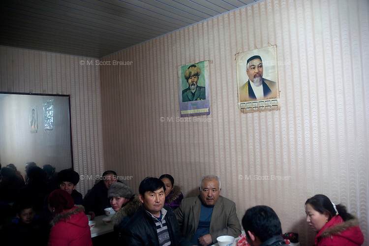 Uighurs gather in a small tea house in the Uighur section of Urumqi, Xinjiang, China.  The city is divided between Han and Uighur ethnic groups and in 2009 saw violent clashes between the groups.