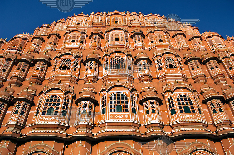 The decorated architecture of The Palace of the Winds (Hawa Mahal) in Jaipur.