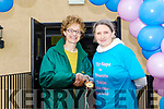 The first woman home in the 10k at the Top of Coom run on Sunday last  was Catherine Murphy who got her medal from organiser Abby O'Leary.